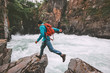 Running man travel adventure active vacations healthy lifestyle endurance extreme sport concept backpacker jumping on cliff above canyon river