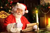Portrait of Santa Claus answering Christmas letters. - 234058172