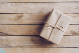 Above brown gift box on wooden table background with copy space. - 234066989