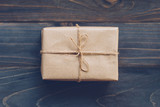 String or twine tied in a bow on kraft paper gift box no wooden table texture and background. - 234067929