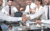 handshake of business people at the meeting at the Desk