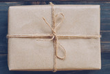 String or twine tied in a bow on kraft paper gift box texture - 234069727