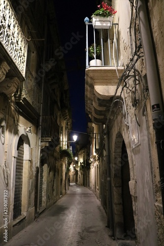 Night at old alley in Ortigia Syracuse, Sicily Italy