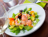 Ceviche from salmon on plate with cumquat, green dill  and avocado - 234120334