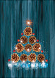 Pine cone christmas tree on wooden background