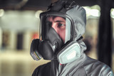 The worker of shop of coloring in overalls and a protective mask - 234135118