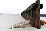 piles at a silent beach