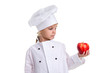 Chef girl in a cap cook uniform, holding the red apple. Looking at the apple. Human emotions, facial expression feeling, attitude