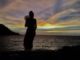 silhouette of woman on the beach at sunset