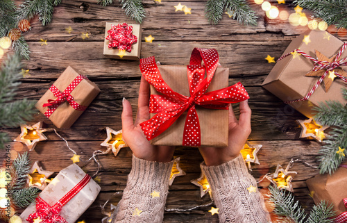 Top view of woman hands with gift box. - 234162346