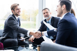 Business people shaking hands, finishing up a meeting. Handshake. Business concept. - 234168971