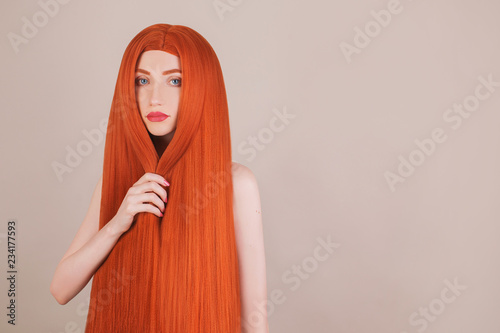 Redhead girl with perfect long hair. Natural beauty. Portrait of young girl with perfect skin. Voluminous red hair. Hair straightening in salon. Keratin straightening. Redhead woman with beauty face