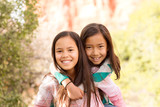 Portrait of young girls smiling and laughing. - 234211595