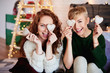 Portrait of playful girls with gingerbread cookies