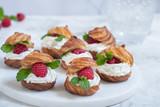 Raspberries Profiteroles with White Chocolate cream