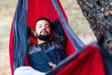 Man relaxing in a hammock on a picnic - 234232963