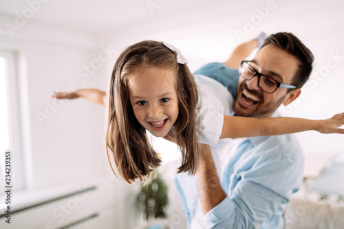 Happy family having fun time at home - 234239351
