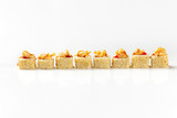Closeup set of sushi rolls with sesame and lava maki isolated at white background. © mayatnik