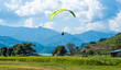 Leinwandbild Motiv paraglider that flies over meadow, Pokhara region, Nepal. Himalayas mountains on the background.
