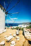 View of Mykonos town and windmill at sunny day - 234250574