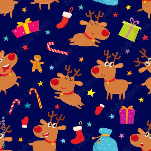 fototapeta na ścianę Seamless pattern with cute cartoon reindeers, vector illustration on blue background.