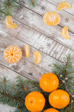 Peeled tangerines on wooden background