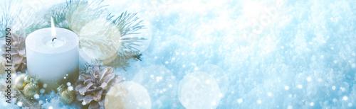 Leinwandbild Motiv Christmas Winter Panorama  -  White candle in sparkling cold snow landscape