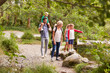 Leinwanddruck Bild - Family Hiking Along Path By River In UK Lake District
