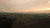 Aerial shot of wind turbine farm at dusk - 234291153