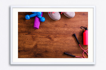 Sneakers, dumbbells and towel. Skipping rope. © tanyastock