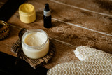 Natural SPA cosmetics on wooden table from above. Warm toned filter. Beauty rituals, skincare, body detoxing, beauty blogger concept - 234326331