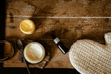 Natural SPA cosmetics on wooden table from above. Warm toned filter. Beauty rituals, skincare, body detoxing, beauty blogger concept - 234326353