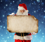 Santa Claus Reading Wish List In Snowy Night  - 234327143