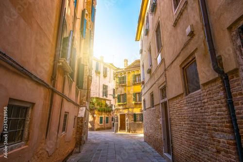 fototapeta na ścianę Italy. Old beautiful Venetian street at sunset