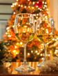 two glasses of champagne on christmas table