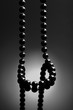 Black necklace on black background. Onyx necklace.  Jewelry concept