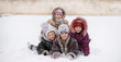 Leinwanddruck Bild - Funny children playing and laughing on snowy winter park