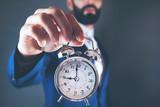 man hand  vintage clock