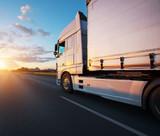 Loaded European truck on motorway in sunset - 234356588