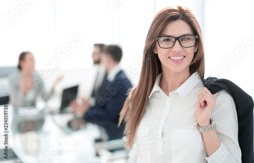 Leinwanddruck Bild modern business woman on the background of the office