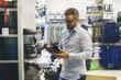 Leinwanddruck Bild - Smiling Young Man in the Shopping