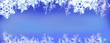 Winder wonderland wide panorama snowy snowflakes on blues header background for winter - 234396145