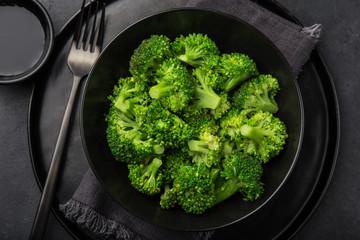 steamed broccoli in black bowl