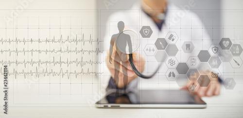 fototapeta na ścianę Doctor using modern computer with Medical record diagram on virtual screen concept. Health monitoring application.