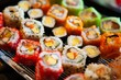 Assortment of tasty and delicious Sushi. Most popular Japanese food. Maki Sushi is vinegared rice filled with raw fish or seafood and wrapped in seaweed. Healthy eating and eat well concept.