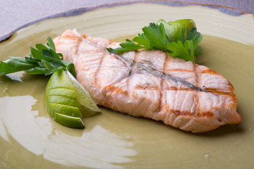Steamed salmon steak served with lime