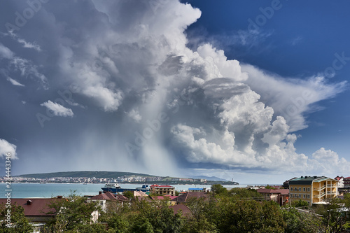 Magic cloudy pattern in the sky over the blue sea in the Black Sea bay of the city of Gelendzhik - 234443346