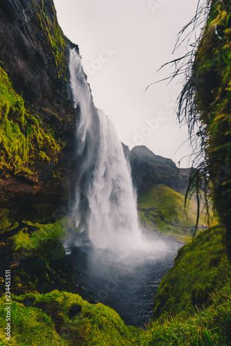 Majestic waterfall Seljalandsfoss in Iceland in autumn in cloudy weather - 234453511