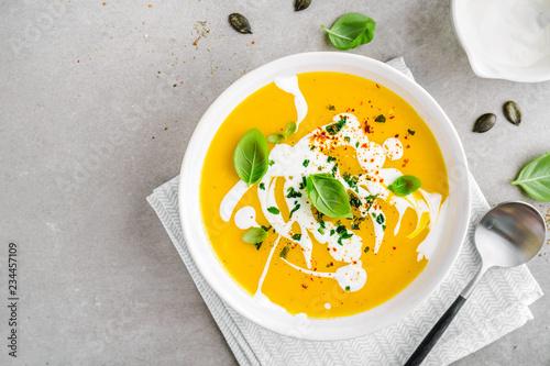 Leinwandbild Motiv Pumpkin creamy soup served in bowl