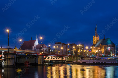 CITYSCAPE - Szczecin by night on banks of the river
